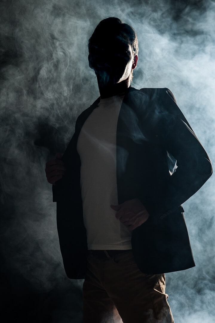 Anonymous Man In Smoky Room