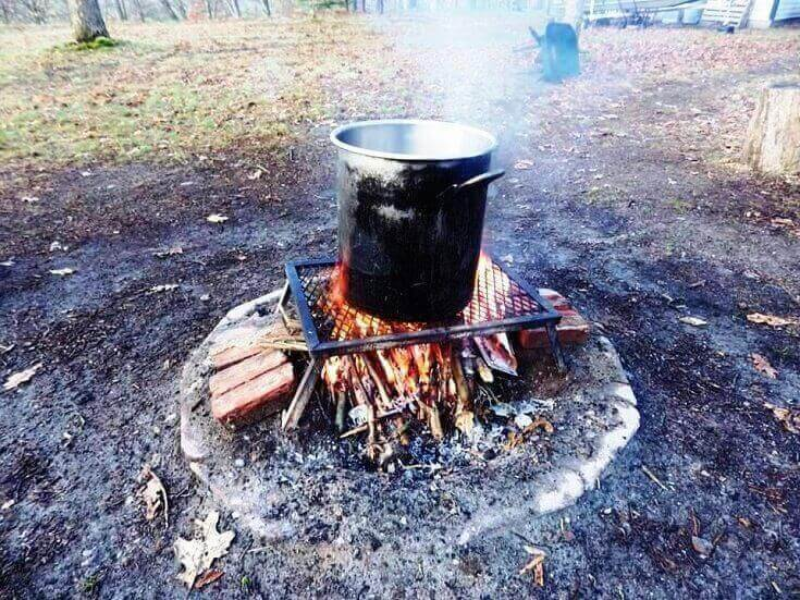 Boiling The Sap Over A Fire