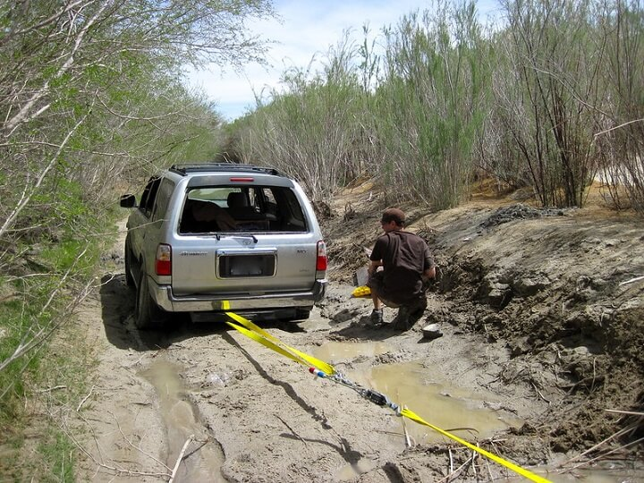 Come-Along Winch Pulling Car Out Of Mud