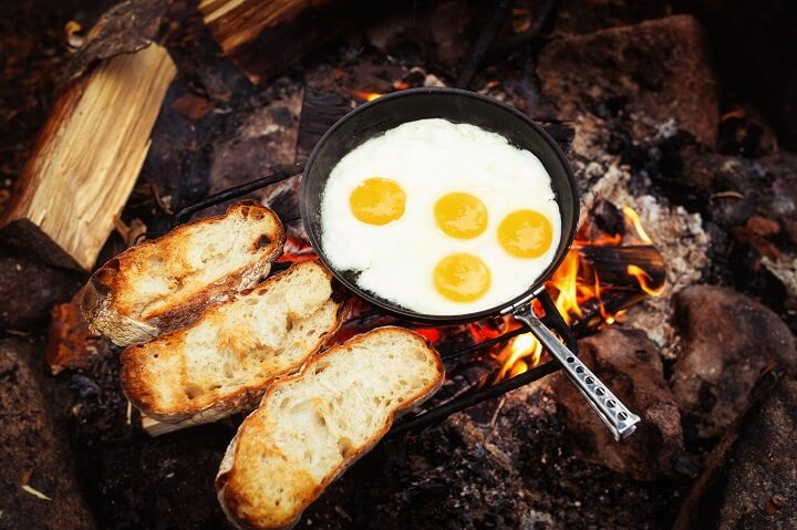 Eggs Cooking In Pan Over Fire
