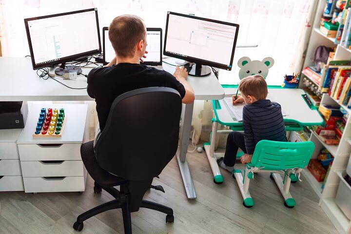 Father Working From Home With Son