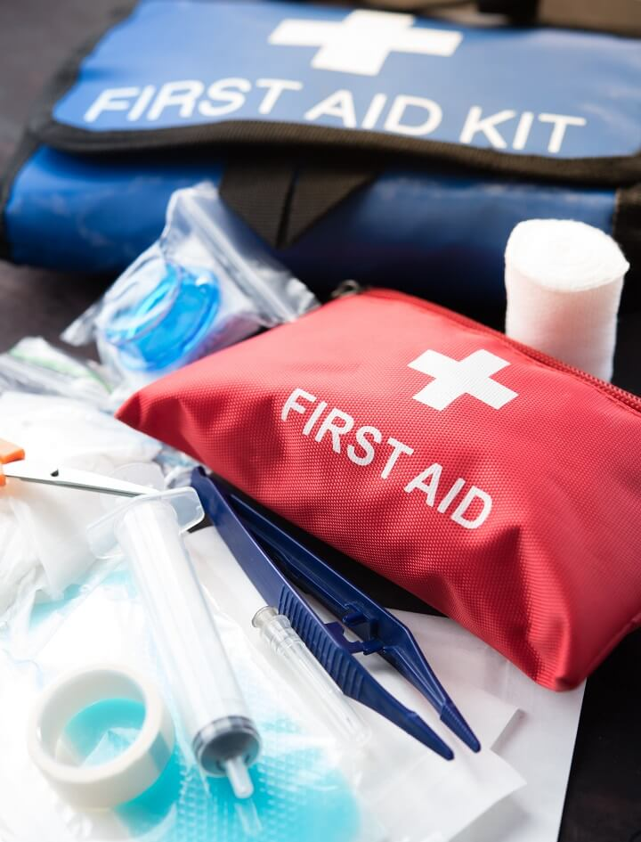 First Aid Kits Lying On Table