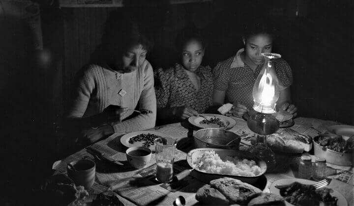 Great Depression Family Eating By Lamplight