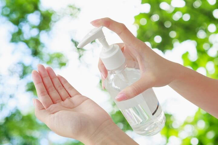 Hand Sanitizer Bottle and Hand