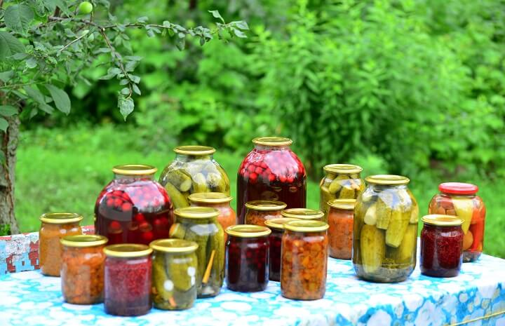 Jars Of Home Canned Vegetables On Table
