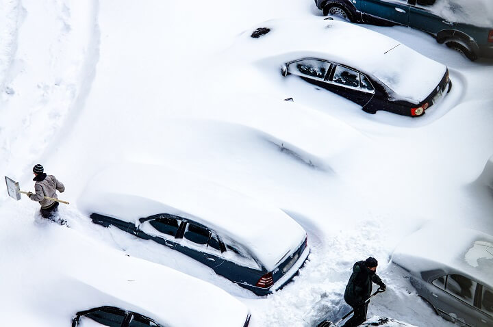 People Digging Cars Out Of Snow