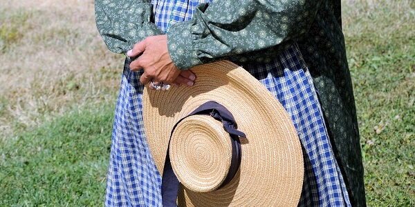 Pioneer Woman Holding Hat