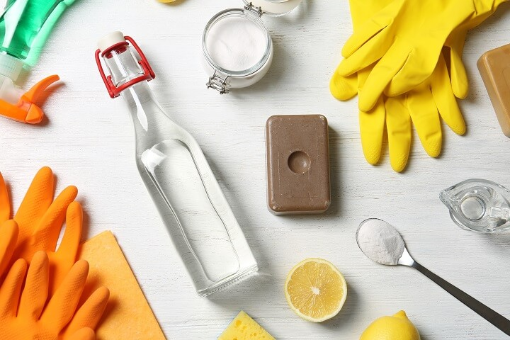 White Vinegar and Cleaning Supplies on Table