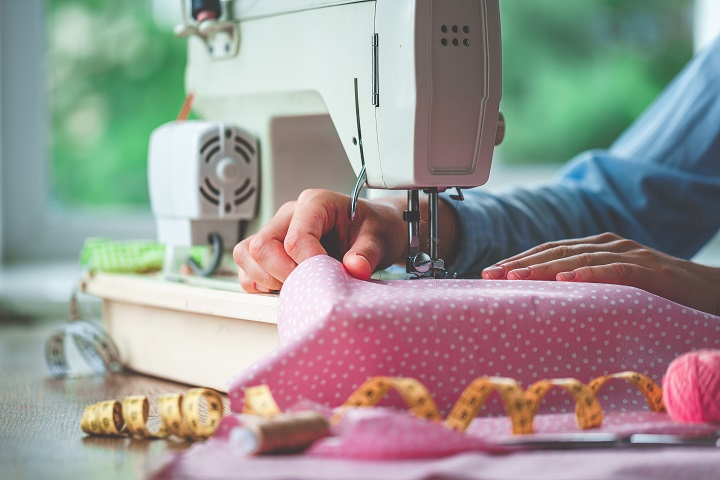 Woman Sewing Dress With Machine